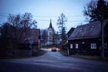 Small Czech Village At Deep Dusk Cars Headlight Lights Up The Road