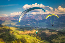 Flying Paragliders From The Stranik Hill Over The Mountainous Landscape Of The Zilina Basin In The North Of Slovakia..Mala Fatra National Park In The Background, Slovakia, Europe.