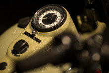 Motorcycle Fuel Tank And Speedometer With Water Drops After Rain. Night Shoot Under Spotlight.