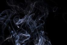 Swirling Blue Smoke On A Black...