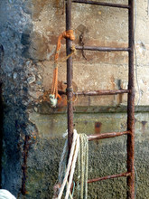 Close Up Of Rusty Ladder Against Wall