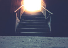 Sunrays Shining Through Staircase Into A Dark Room