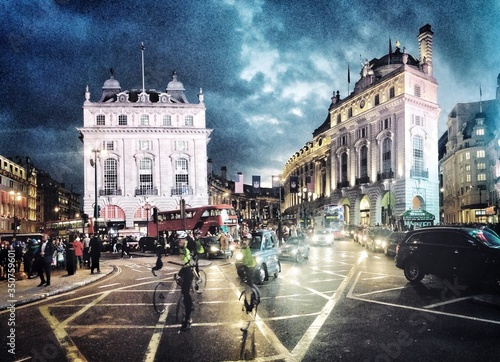 Piccadilly Circus At Night In City Canvas Print