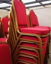 Stack Of Red Chairs In Room