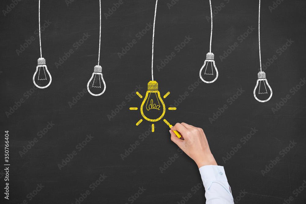 Fototapeta Creative idea concepts with light bulbs on a blackboard background