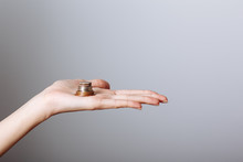 Woman's Hand Holding Coins Iso...