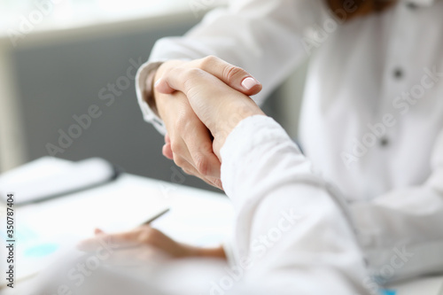 Witty corporation handshake Canvas Print