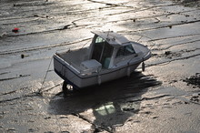 High Angle View Of Boat Moored In Mud