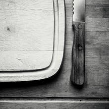 Directly Above Shot Of Steak Knife And Cutting Board On Table