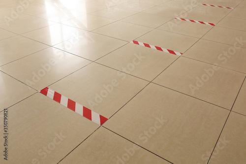Slika na platnu Warning sticky tape on floor indoors. Concept of social distance