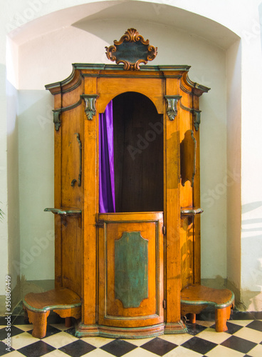 church interior, confessional, ready to absolve you from your sins Canvas Print