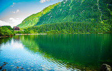 Mountain Lake With Wooden Hous...
