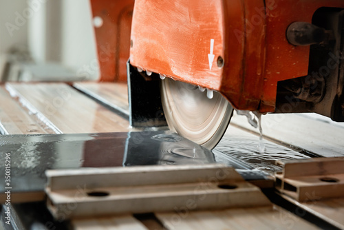 Leinwand Poster The diamond disk of a wet saw.