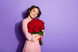 Leinwanddruck Bild - Portrait of nice-looking attractive lovely pretty sweet cheery dreamy girl holding in hands hugging roses 14 February isolated on bright vivid shine vibrant lilac violet purple color background