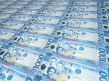 A Background Of Neat Rows Of 1000 Philippine Peso Bills. Philippine Currency. Paper Money Or Banknotes Of The Philippines.