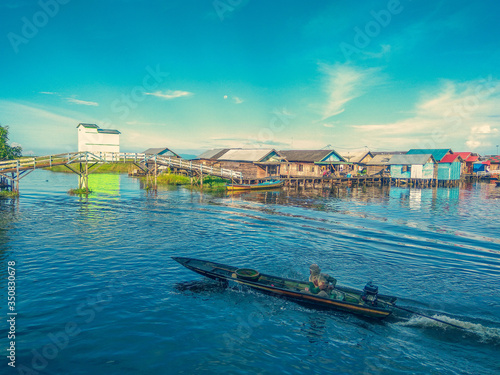 Fototapeta High Angle View Of Man On Motorboat Sailing In River