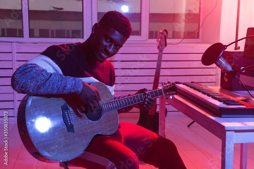 Create music and a recording studio concept - african american man guitarist rec Wallpaper Mural