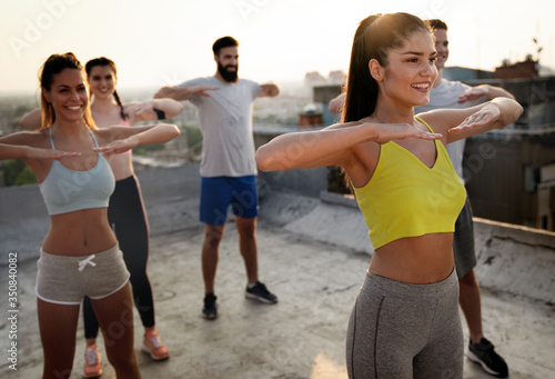 Fototapeta Group of fit healthy friends, people exercising together outdoor obraz