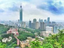Taipei 101 Amidst Buildings Against Cloudy Sky In City