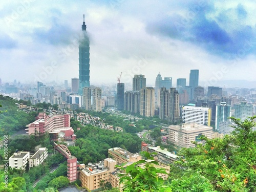 Taipei 101 Amidst Buildings Against Cloudy Sky In City Canvas Print