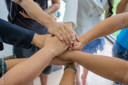 Fototapety, obrazy: Many multiracial hands coming together as a team..