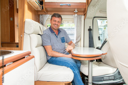 man in campervan motor van home vanlife vacation in camper RV car Fotobehang