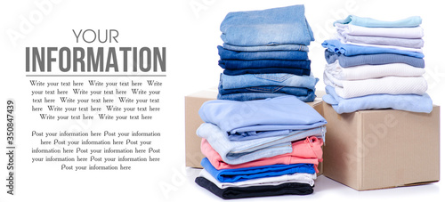 Stack of clothing in cardboard box isolated on white background, space for text Fototapeta