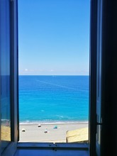 Scenic View Of Sea Against Clear Blue Sky Seen Through Window