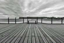 Empty Bench On Pier By Sea Aga...