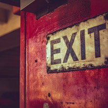 Old Exit Sign On Red Metal In ...