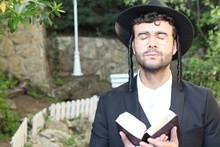 Man Praying With Eyes Closed