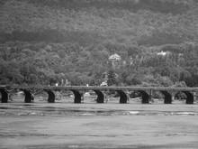 Rockville Bridge Over Susquehanna River Against Tree Mountain