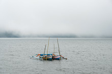 Two Kanoo Boats On The Foggy M...