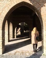Rear View Of Woman Walking In Corridor At Castello Di Grazzano Visconti