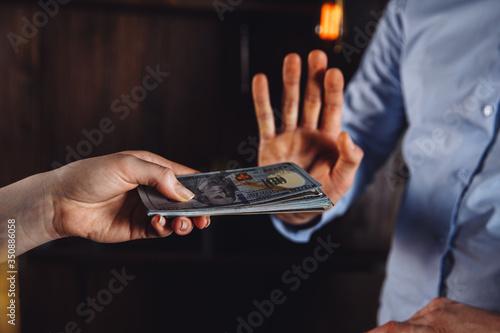 Bribery and anti corruption concept. Man refusing from money Slika na platnu