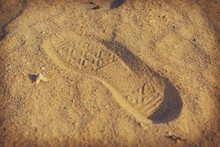 High Angle View Of Shoe Print On Sand At Beach