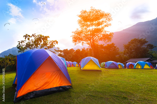 Fototapeta The Colorful Camping Tents  near mountain  in the morning obraz
