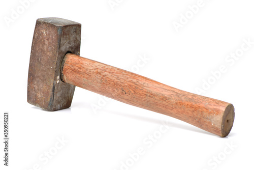 Tableau sur Toile old sledge hammer with wooden handle on a white background