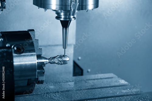 Photo The 4-axis CNC milling machine cutting the  sample parts with solid ball endmill tools
