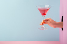 Woman's Hand Holding A Glass O...