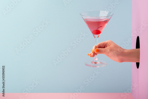 Woman's hand holding a glass of red prosecco Fototapeta