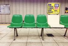 Empty Chairs On Sidewalk