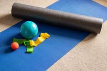 Foam Roller And Pilates Equipment On Floor Mat