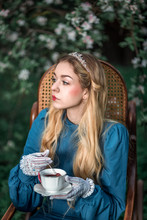 Princess With A Teacup Which Something Has Fallen Into