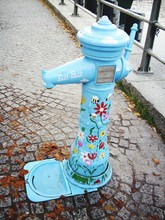 Close-up Side View Of Blue Fire Hydrant