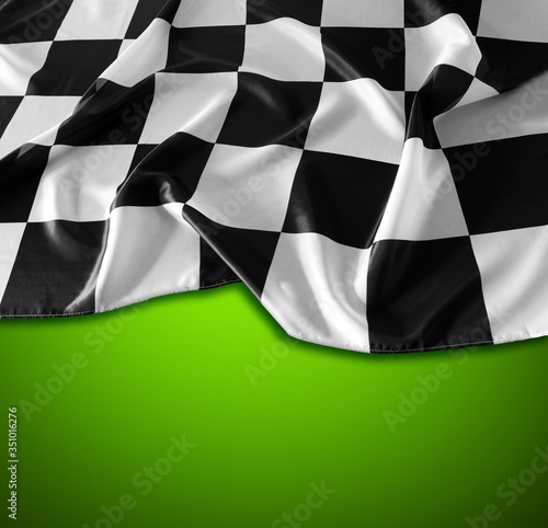 Checkered flag on green