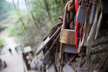 Old Padlocks Attached To Railing