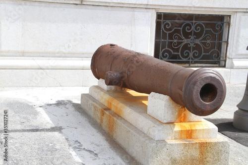 Vászonkép Cannon Against Building