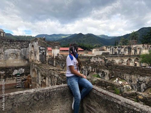 Cuadros en Lienzo young woman looking at the old town and Volcano in Antigua Guatemala