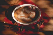 Pumpkin Pie Sprinkled With Sugar And Cinnamon Forming A Picture Of A Dove Carrying A Heart In Its Beak On A Red Napkin And On A Wooden Table. Love Pie.